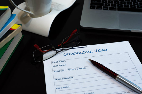 A curriculum vitae paper on a desk