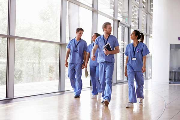 A group of nurses walking in a hospital