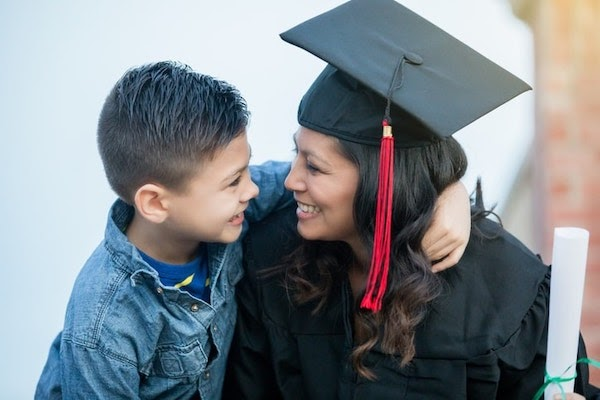 Woman celebrating graduation with child