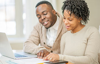 African-American couple working on documents