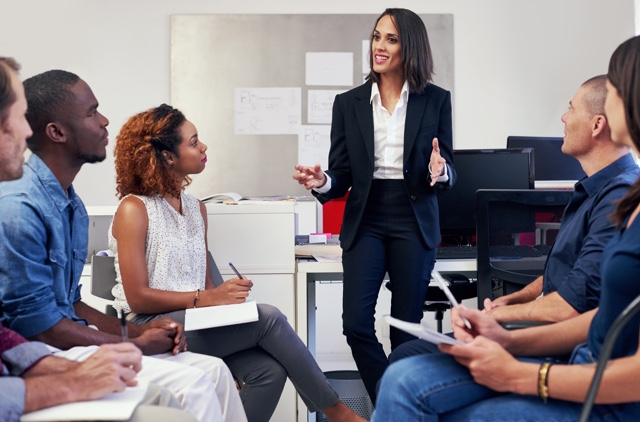 business professional leading a meeting