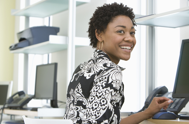 woman smiling in office setting
