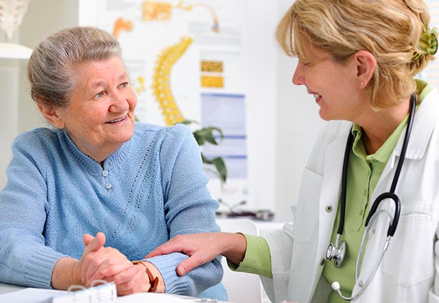 health care professional with elderly patient