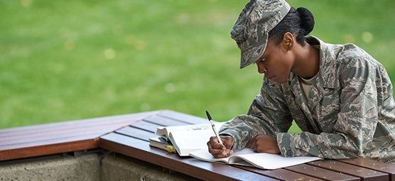 military student studying outside