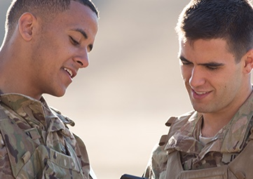two military students talking